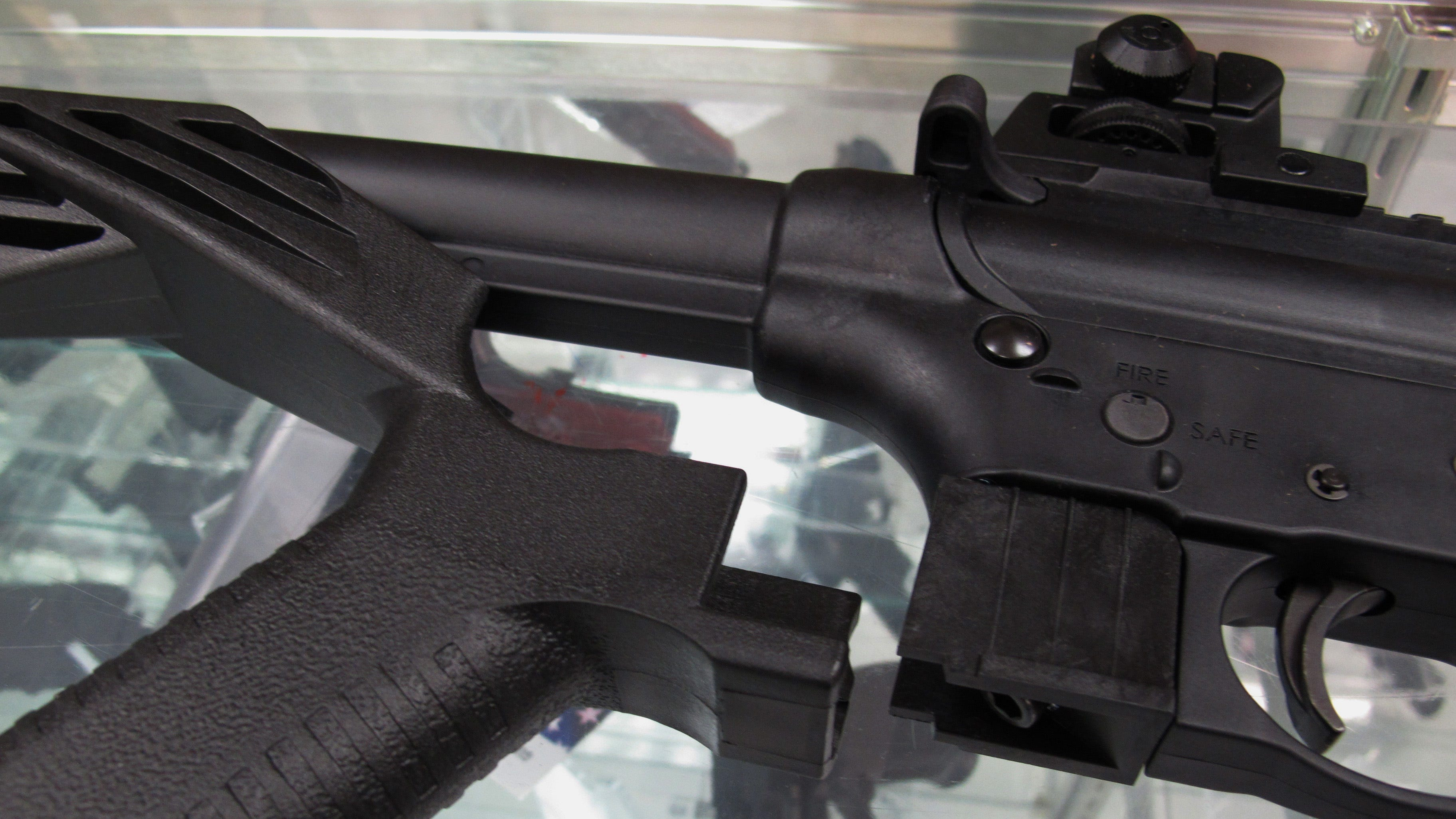 A bump stock is seen to a disassembled .22-caliber rifle at North Raleigh Guns in Raleigh, N.C.