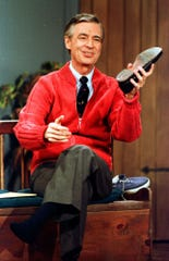 "ORG XMIT: NY206 FILE - This June 28, 1989 file photo shows Fred Rogers as he rehearses the opening of his PBS show ""Mister Rogers' Neighborhood"" during a taping in Pittsburgh. (AP Photo/Gene J. Puskar, File)"