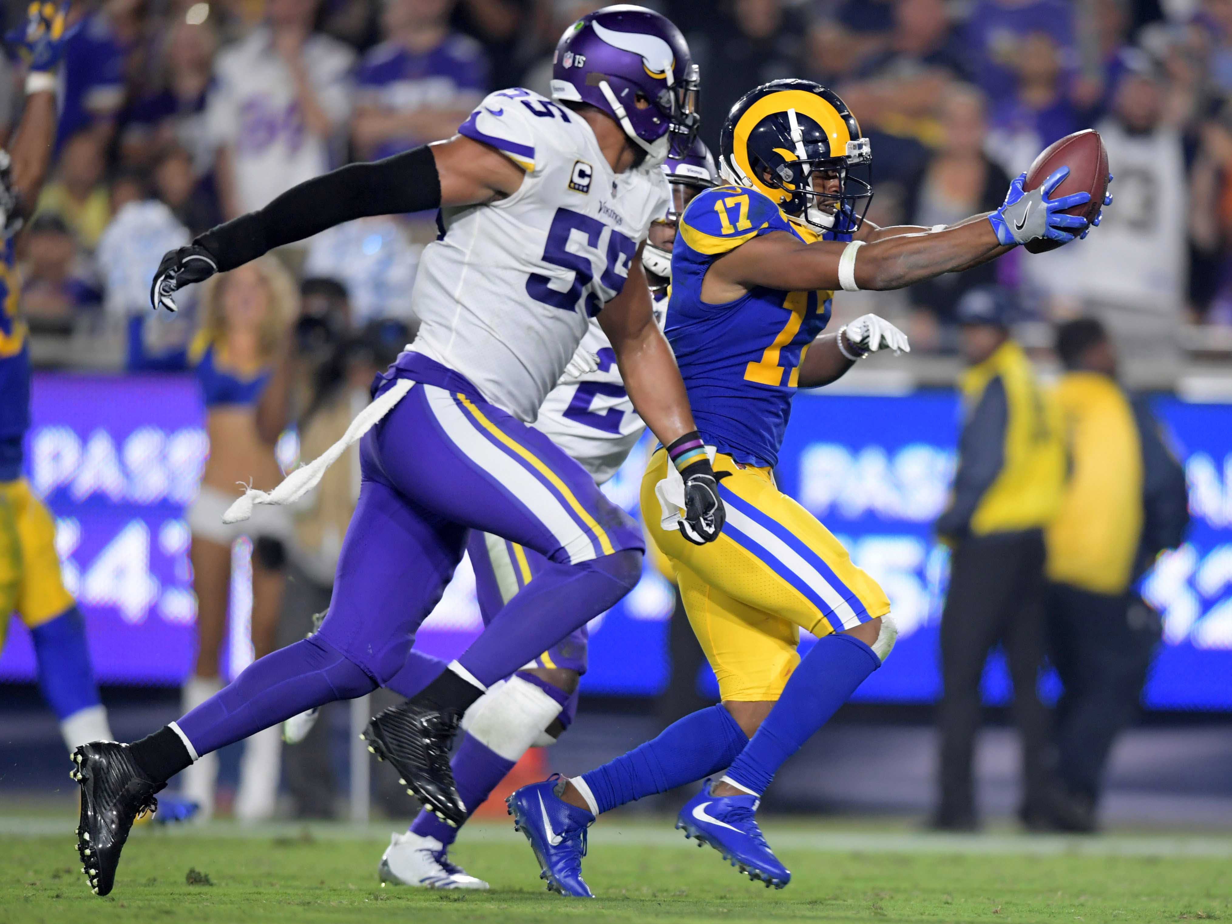 Los Angeles Rams wide receiver Robert Woods is pursued by Minnesota Vikings linebacker Anthony Barr on a 31-yard touchdown reception in the fourth quarter at Los Angeles Memorial Coliseum.