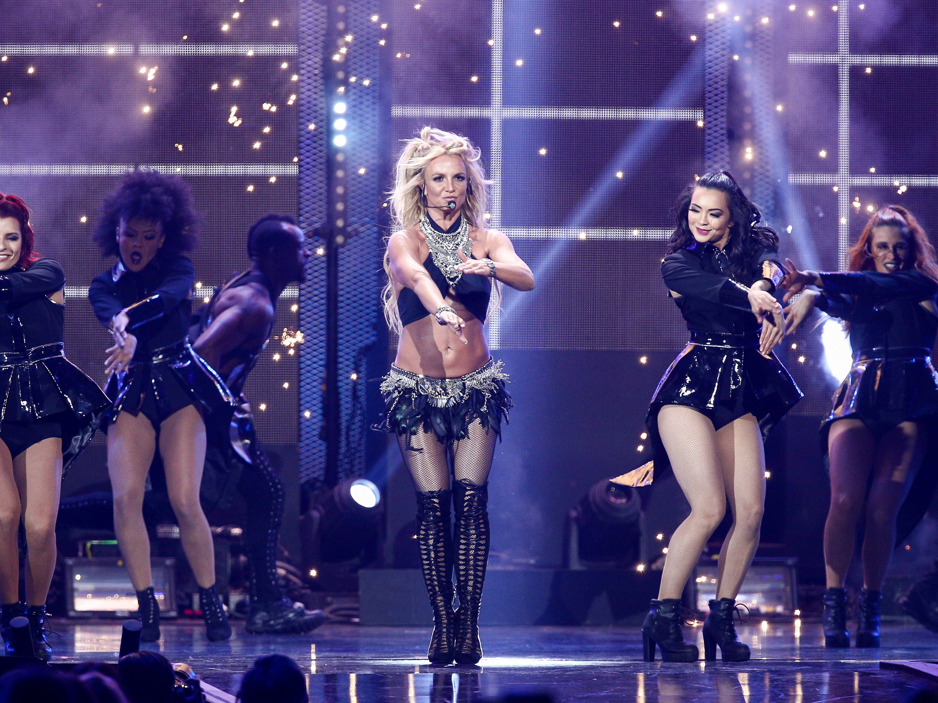 FILE - In this Sept. 24, 2016 file photo, Britney Spears performs at the 2016 iHeartRadio Music Festival - Day 2 held at T-Mobile Arena  in Las Vegas. Spears is donating some of her Las Vegas show ticket sales to Louisiana schools for flood recovery. The Kentwood, Louisiana native announced that $1 of every ticket sold through the end of the year will go to public schools in a partnership with the Louisiana School Boards Association. (Photo by John Salangsang/Invision/AP) ORG XMIT: NY115