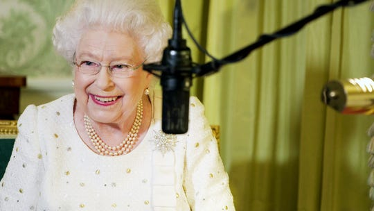 Queen Elizabeth II prepares a radio address in the film