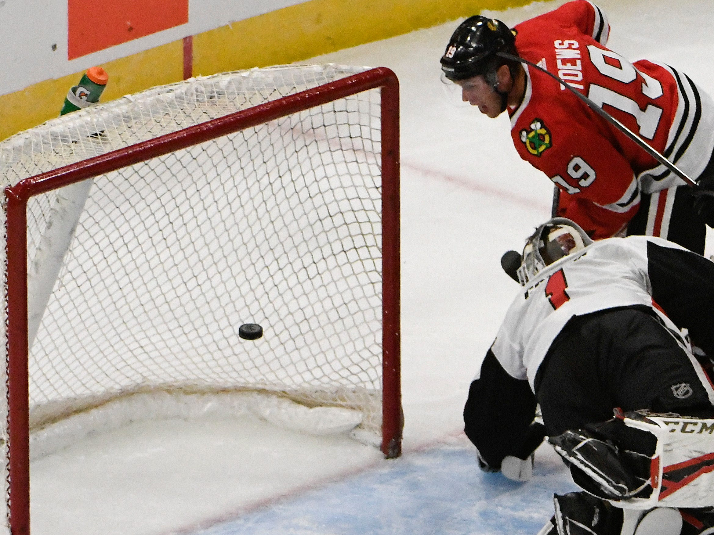 Sept 27: Chicago Blackhawks center Jonathan Toews scores past Ottawa Senators goaltender Mike Condon.
