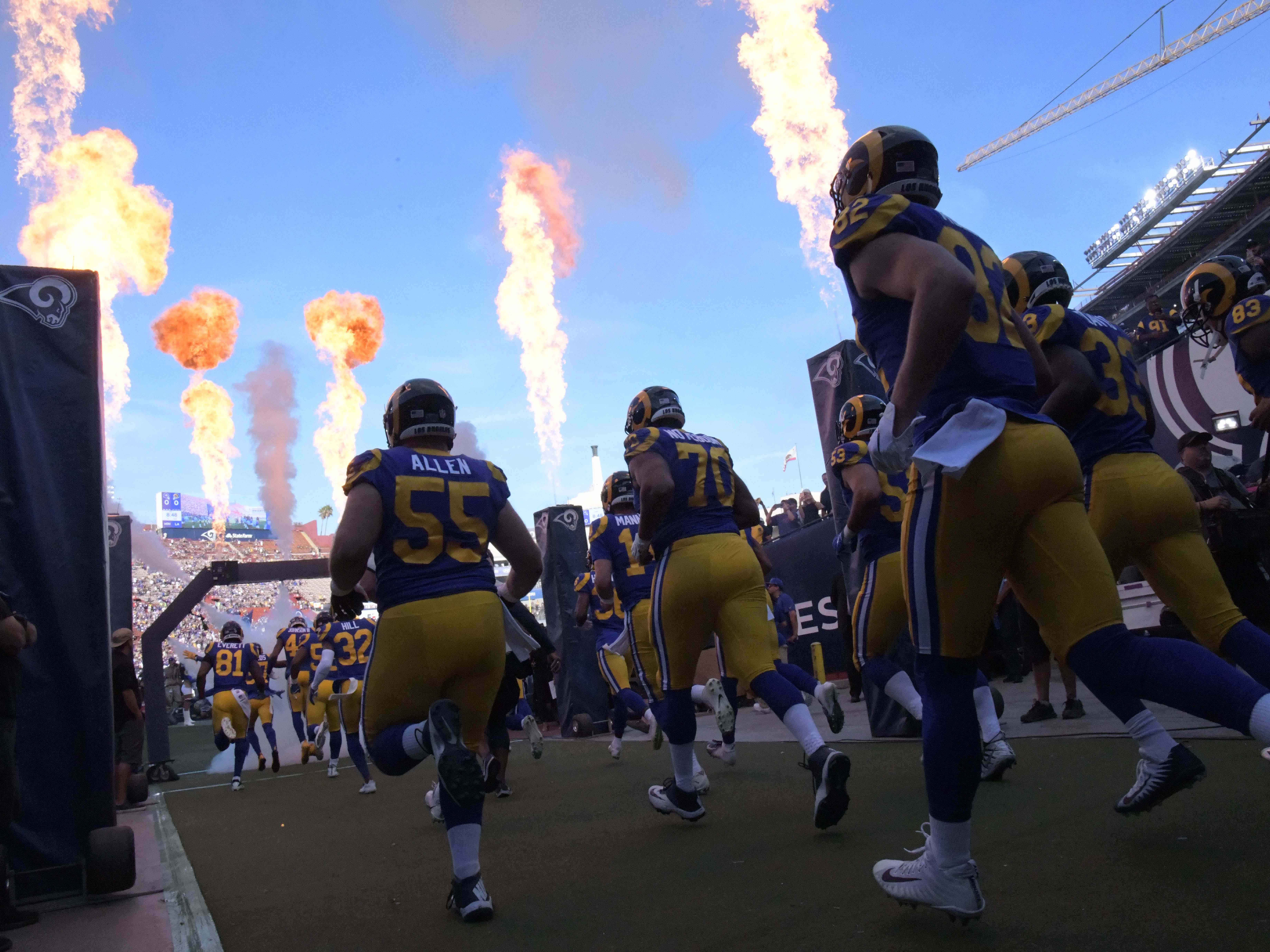 Los Angeles Rams players enter the field thorough flames before the game against the Minnesota Vikings at Los Angeles Memorial Coliseum.