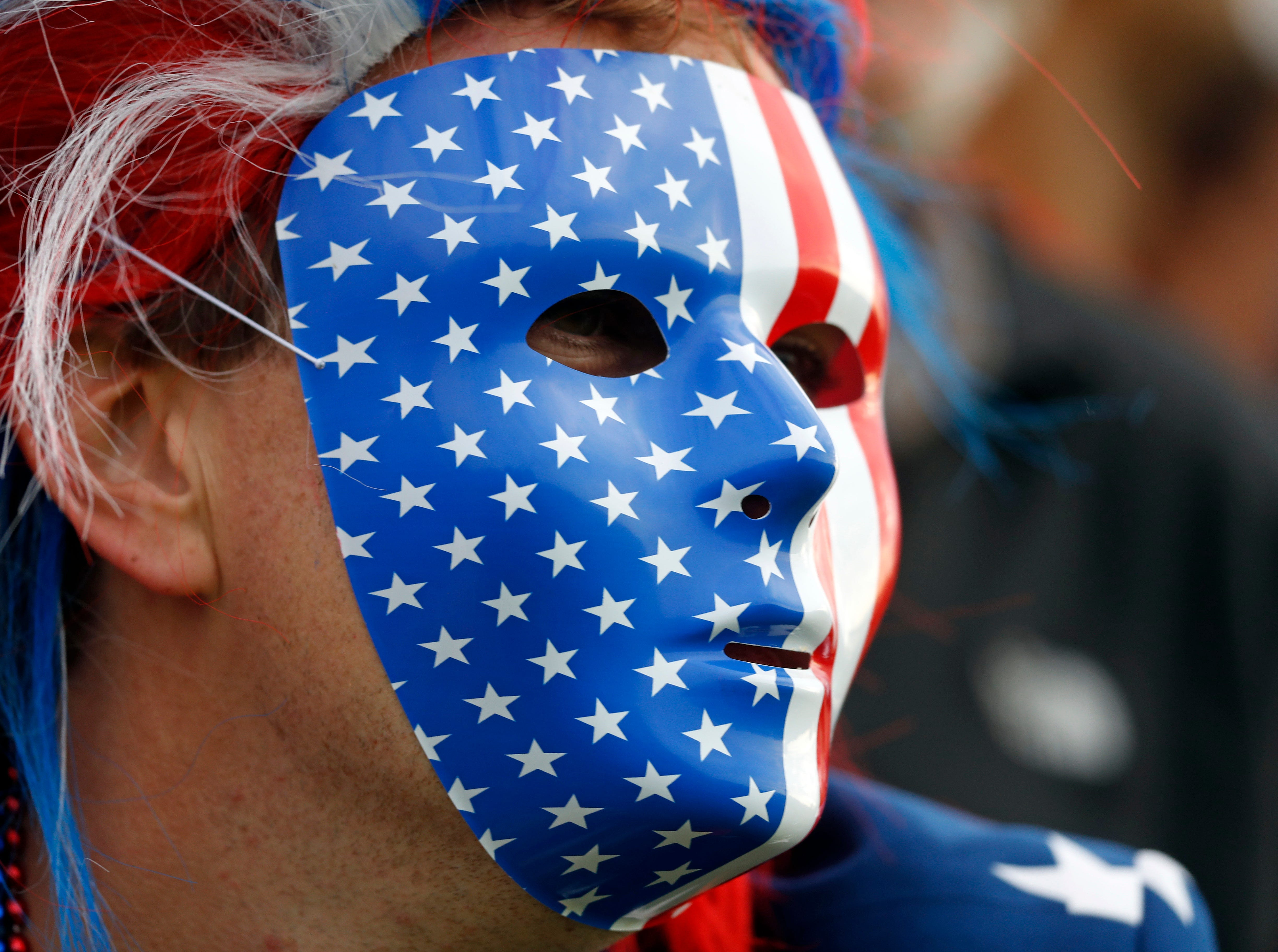 A US supporter watches on the opening day of the 42nd Ryder Cup at Le Golf National in Saint-Quentin-en-Yvelines, outside Paris, on Sept. 28.