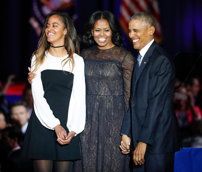 President Barack Obama  with first lady Michelle Obama and elder daughter Malia Obama after his farewell address at McCormick Place in Chicago, January 10, 2017.