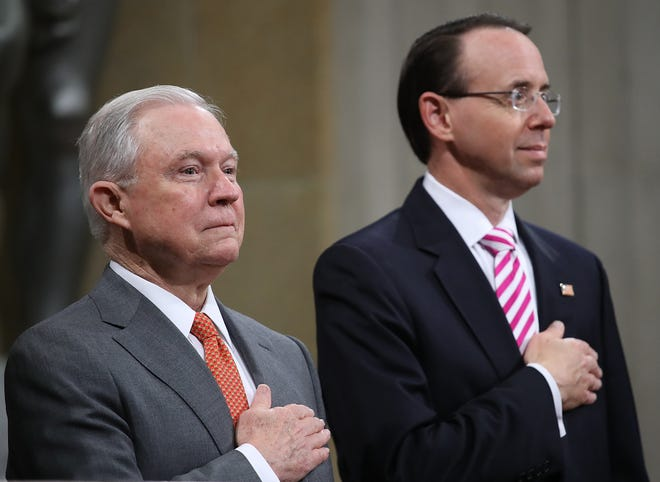 Attorney General Jeff Sessions (L) and Deputy Attorney General Rod Rosenstein (R) attend the Religious Liberty Summit at the Department of Justice July 30, 2018 in Washington, D.C.