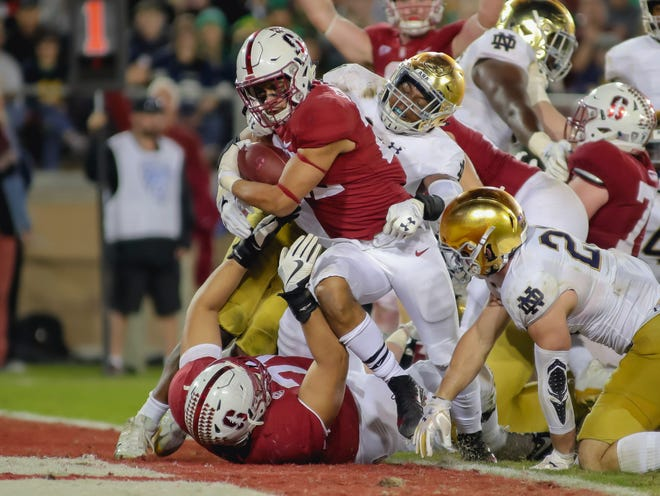 Stanford running back Cameron Scarlett  runs in for a touchdown against Notre Dame during their game in 2017.