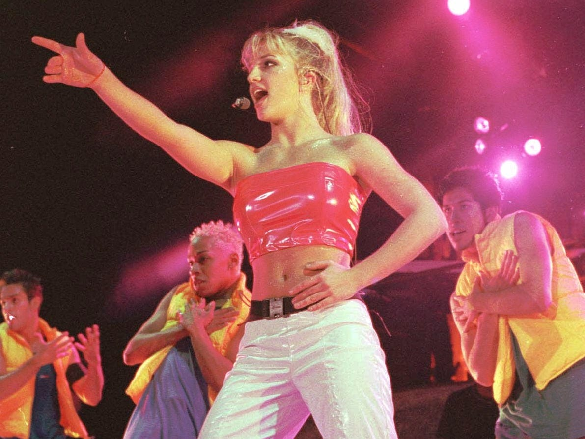 """Britney Spears kicks off her """"Baby One More Time"""" tour at the Pompano Beach Amphitheater Monday, June 28, 1999, in Pompano Beach, Fla. Spears, from Kentwood, La., will tour through mid September. (AP Photo/Terry Renna) ORG XMIT: FLTR101 [Via MerlinFTP Drop]"""