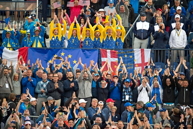Fans cheer on the first hole during the Ryder Cup Friday morning matches at Le Golf National.