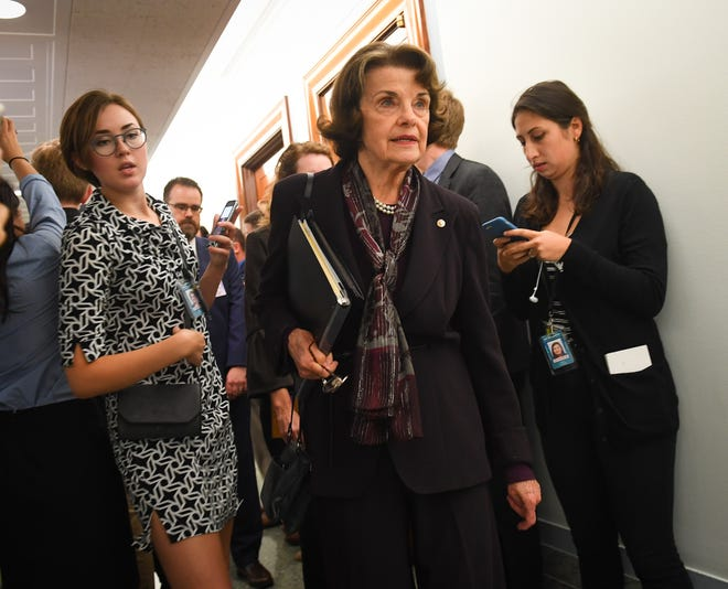 Sen. Dianne Feinstein, D-Calif., departs the Senate Judiciary Committee room following last-minute maneuvering on the vote on Brett Kavanaugh for Associate Justice of the Supreme Court on Sept. 28, 2018, in Washington.