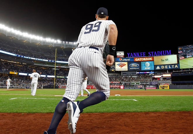 Sep 14, 2018; Bronx, NY, USA; New York Yankees right fielder Aaron Judge #99 takes the field against the Toronto Blue Jays during the eighth inning at Yankee Stadium. Mandatory Credit: Adam Hunger-USA TODAY Sports