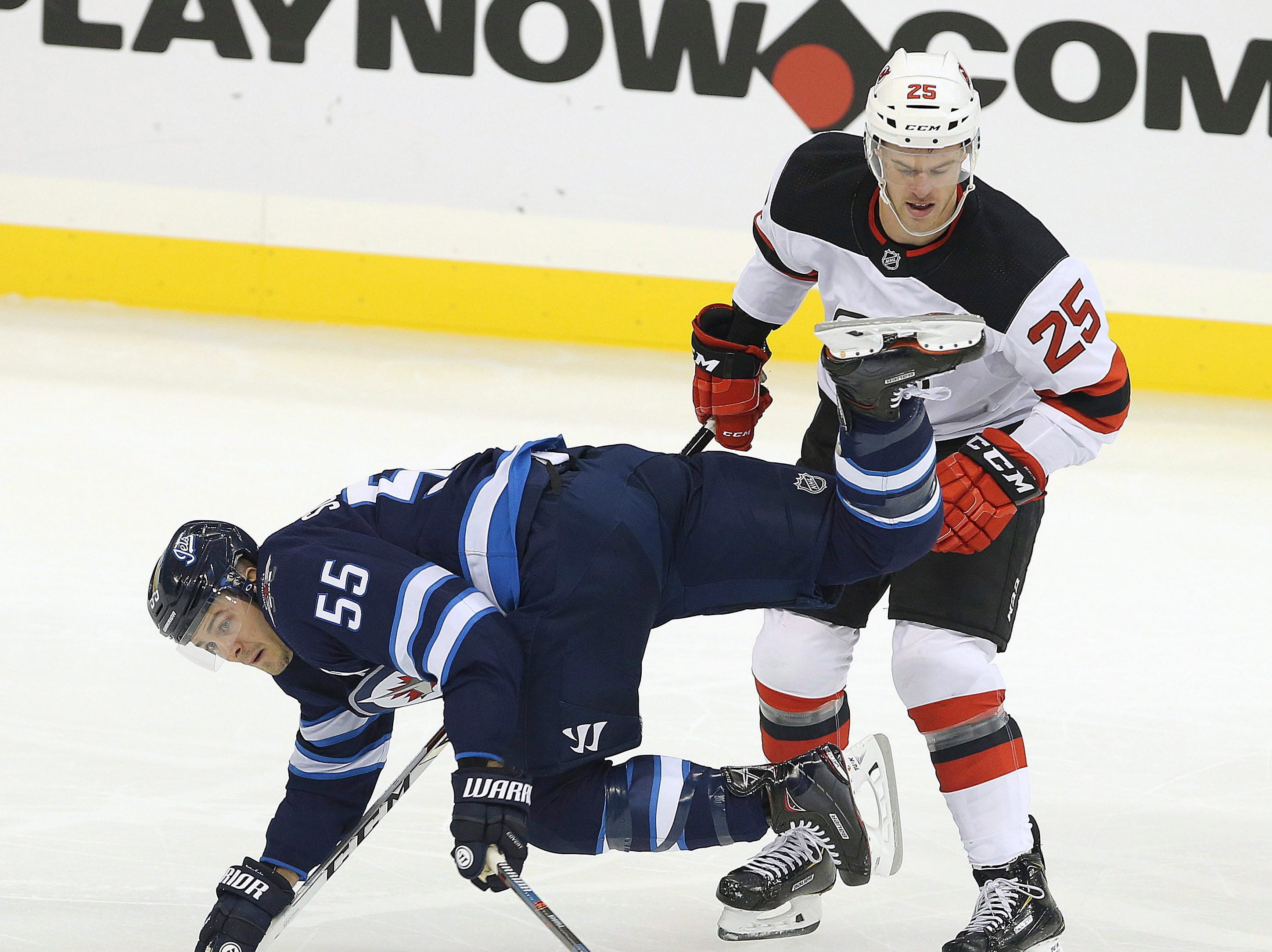 Sept. 27: Winnipeg Jets forward Mark Scheifele is tripped by New Jersey Devils defenseman Mirco Mueller.