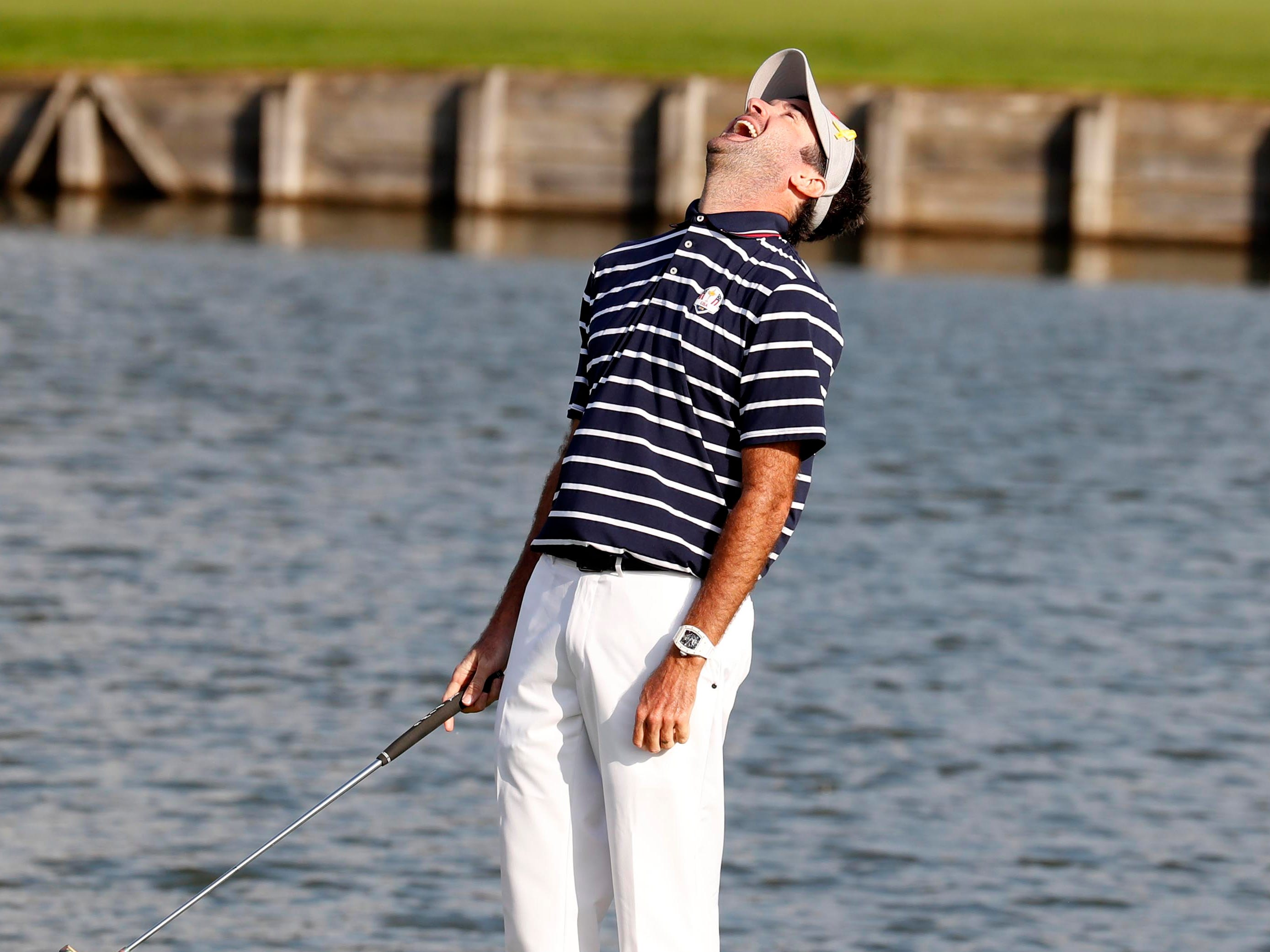Bubba Watson reacts to missing a putt on the 15th green during the Ryder Cup Friday afternoon matches.