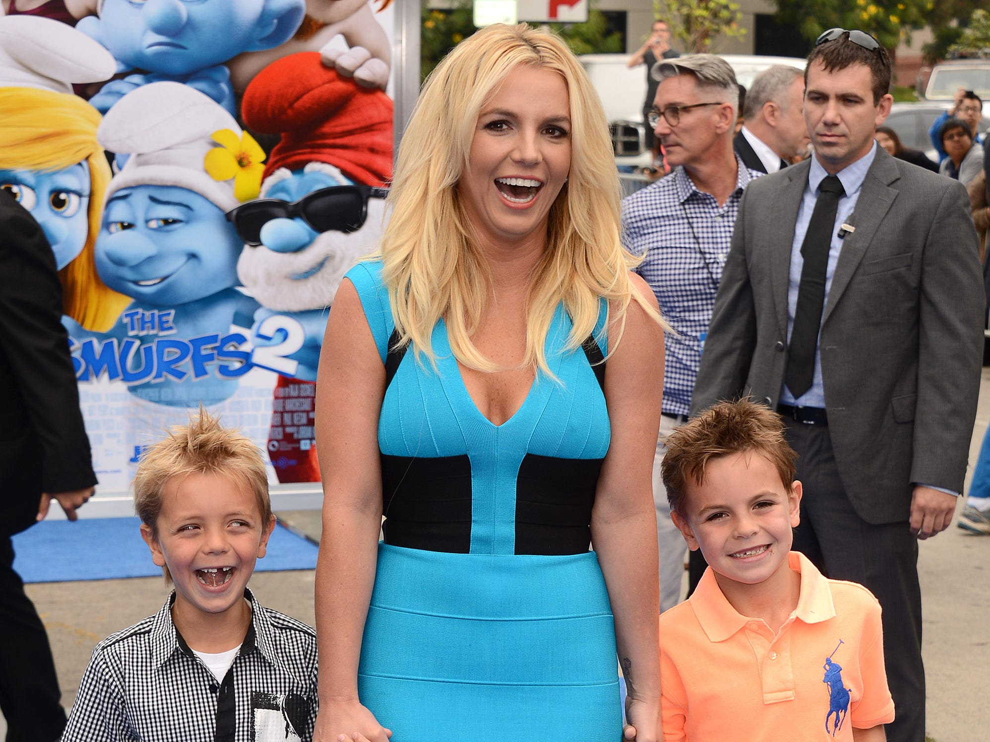"""Britney Spears, center, with sons Sean Federline and Jayden James Federline arrives at the world premiere of """"The Smurfs 2"""" at the Regency Village Theatre on Sunday, July 28, 2013 in Los Angeles. (Photo by Jordan Strauss/Invision/AP) ORG XMIT: CAJS104"""