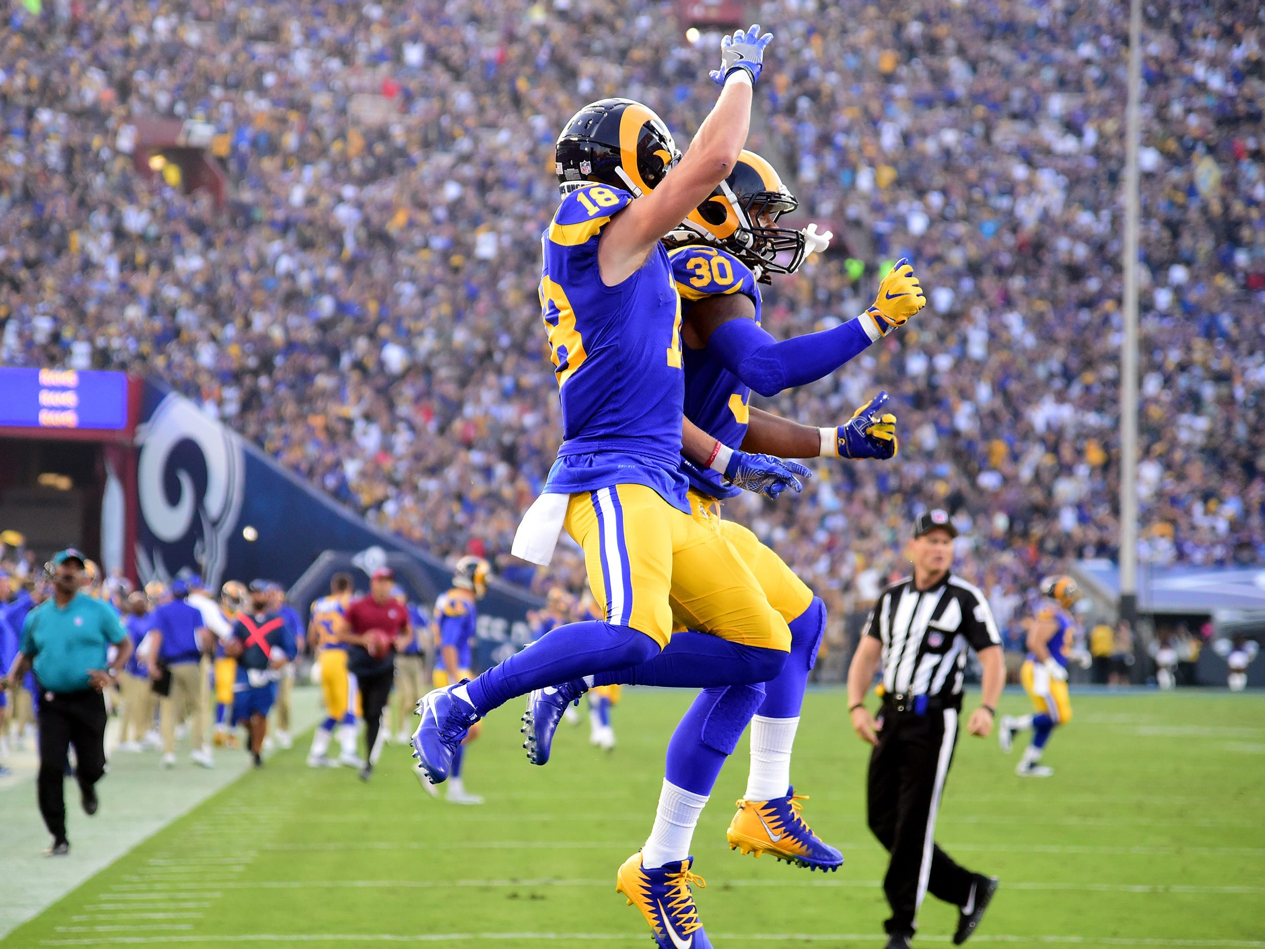 Los Angeles Rams wide receiver Cooper Kupp (18) celebrates with Todd Gurley after catching a touchdown pass.
