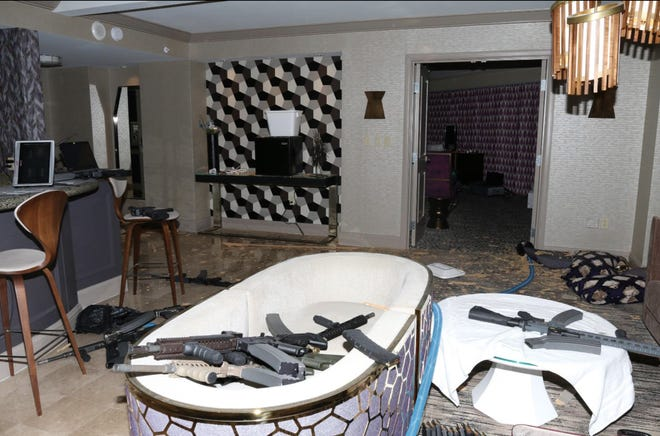 A view from the sitting area of room 32-135 at the Mandalay Bay Hotel shows the various guns Stephen Paddock had in his possession.