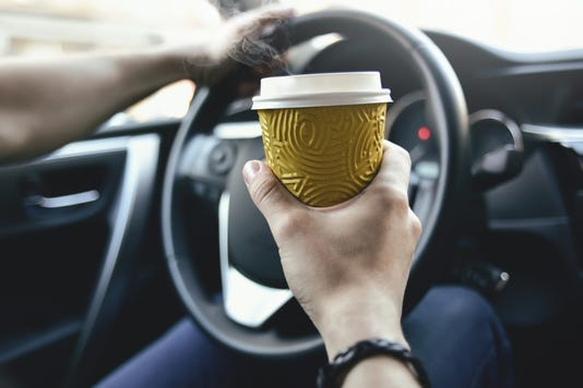 Male Hold Coffee And Drive The Car
