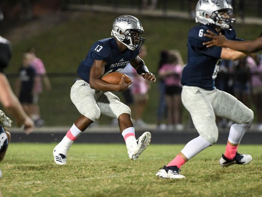 Powdersville senior Tay Cureton runs during the first quarter at Powdersville High School on Friday, September 28, 2018.