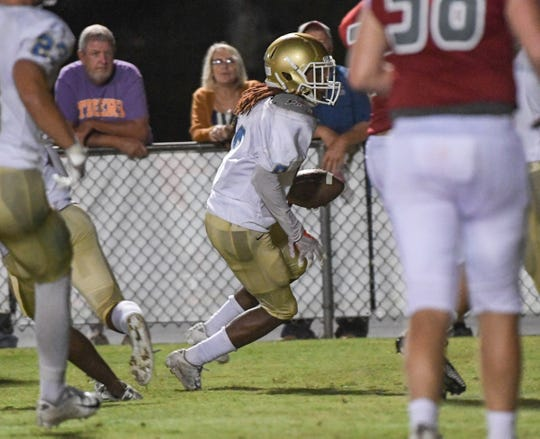 DW Daniel defensive back Addison Daniel(8) returns an interception during the second quarter at Palmetto High School in Williamston on Friday, September 28, 2018.