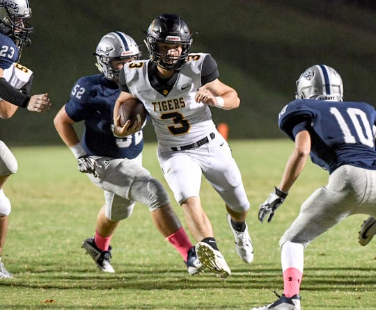 Crescent senior Dawson Merk runs near Powdersville Caden Beck during the first quarter at Powdersville High School on Friday, September 28, 2018.