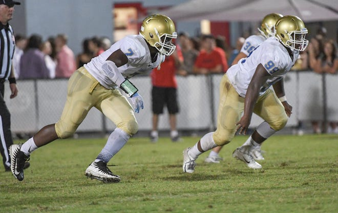 DW Daniel junior Jared Kirksey(7) and lineman Thaddeus Major(98) rush against Palmetto during the second quarter at Palmetto High School in Williamston on Friday, September 28, 2018.