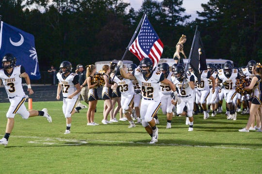 Crescent runs on the field before the first quarter with at Powdersville High School on Friday, September 28, 2018.