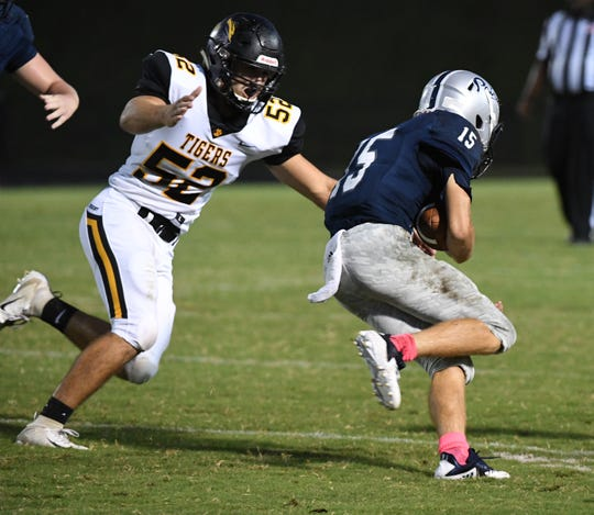 Crescent senior CC Spires sacks Powdersville sophomore Cole Bracken during the first quarter at Powdersville High School on Friday, September 28, 2018.