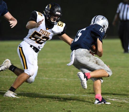 Crescent senior CC Spires sacks Powdersville sophomore Cole Bracken during the first quarter at Powdersville High School on Friday, September 28, 2018.