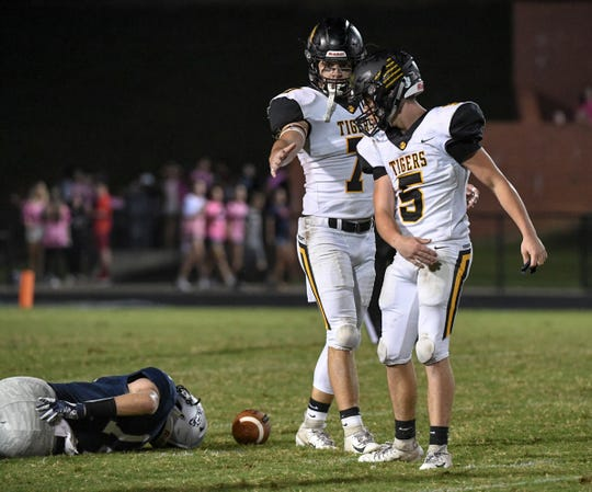Powdersville sophomore Cole Bracken is sacked by Crescent junior Jayden Vincent during the first quarter at Powdersville High School on Friday, September 28, 2018.