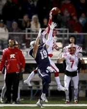 Kimberly's Drew Lechnir breaks up a pass intended for Appleton North's Ryan Balck during Friday's game.  Wm. Glasheen/USA TODAY NETWORK-Wisconsin.