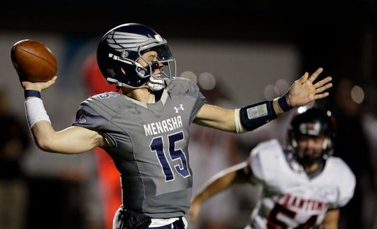 Quarterback Cole Popp of Menasha passes against West De Pere in a Bay Conference game at Calder Stadium in Menasha.