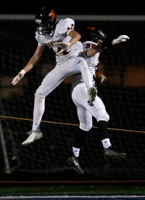 West De Pere's Marcus VanVreede and Evan Frisque celebrate following a touchdown against Menasha in a Bay Conference football game Friday at Calder Stadium in Menasha.