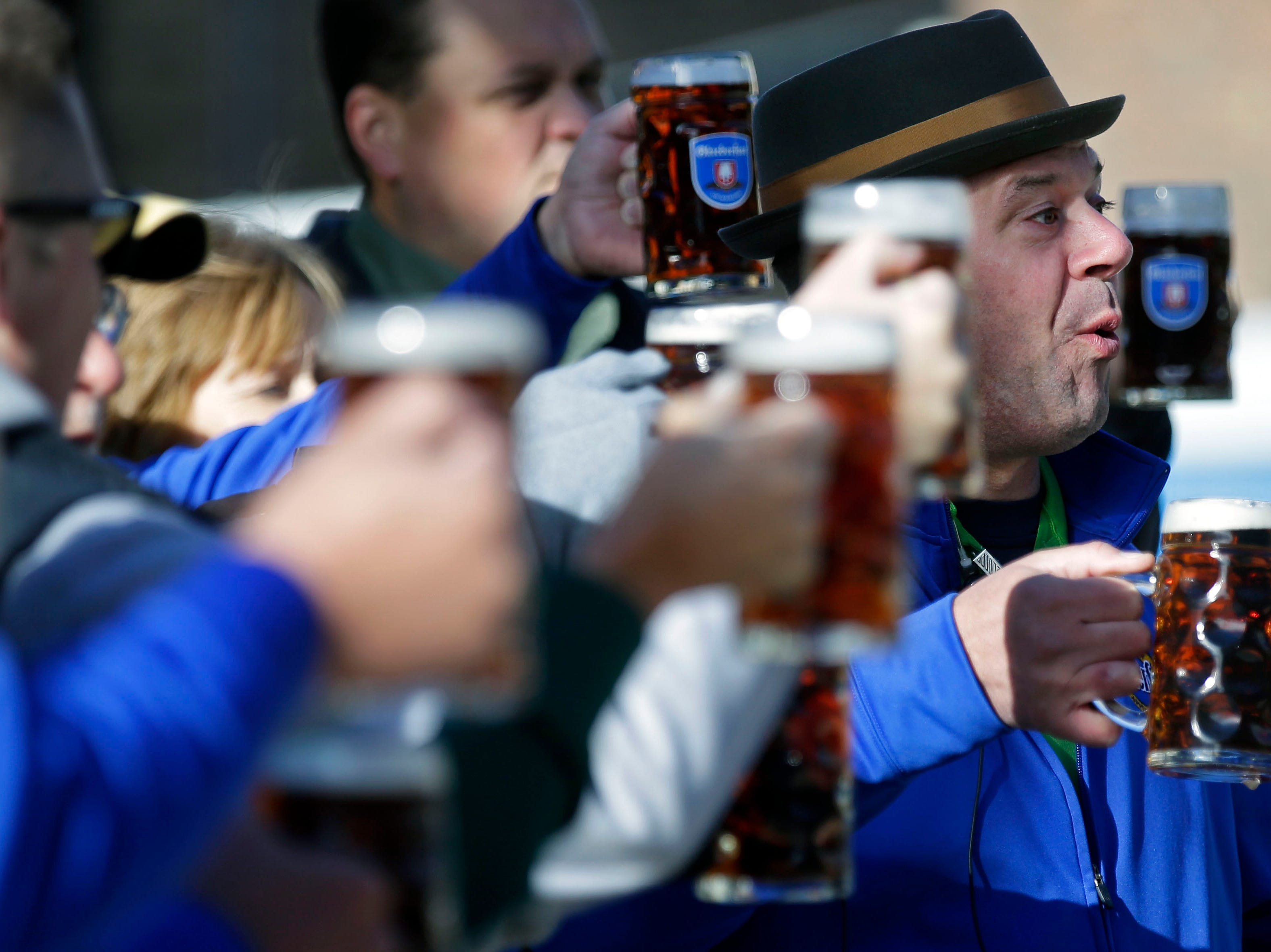 Octoberfest chairman Eric Stadler counts down to the official opening toast as Octoberfest 2018 takes place Saturday, September 29, 2018, in downtown Appleton, Wis.