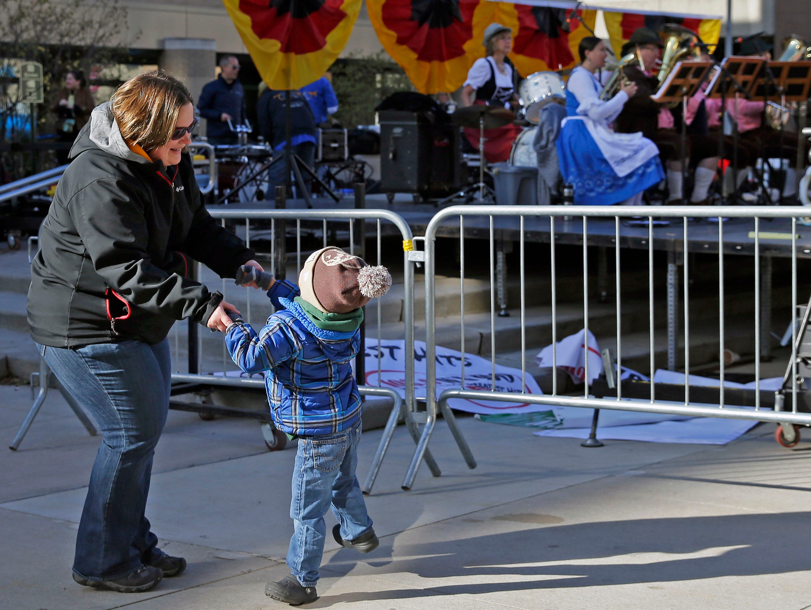 Stacey Grosnick and her nephew Grant Grosnick dance as the Newtonburg Oktoberfest Band performs during Octoberfest 2018 Saturday, September 29, 2018, in downtown Appleton, Wis.