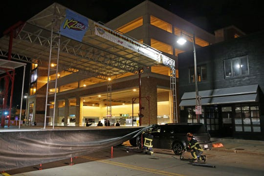 Appleton Police were investigating after a car struck an Octoberfest stage on Division Street late Friday.