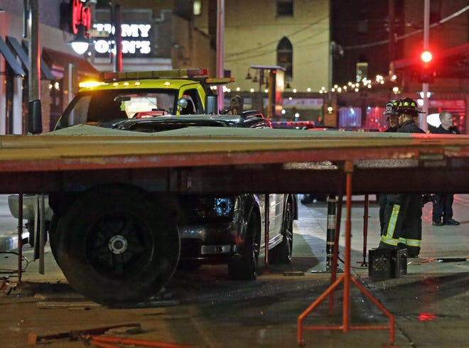 A car struck an Octoberfest stage on Division Street late Friday in downtown Appleton.