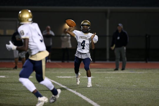 Freehold's quarterback Sha'kim Shuler looks for a pass during the second half of the Freehold Boro vs. Rumson-Fair Haven homecoming football game at Rumson-Fair Haven High School in Rumson, NJ Friday, September 28, 2018.