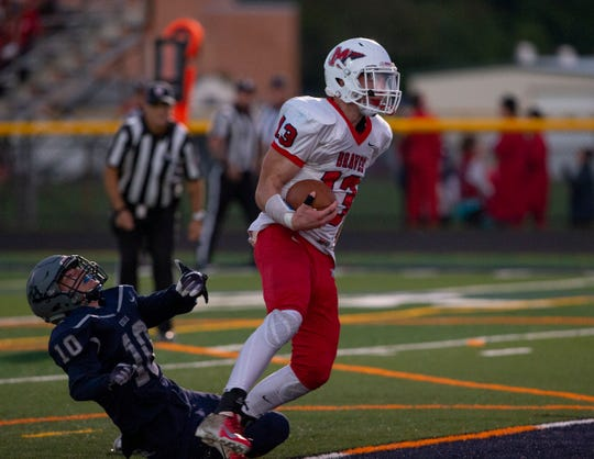 Manalapan's Dale Sieczkowski scores a first quarter touchdown against Howell. Manalapan Football vs Howell in Howell, NJ on September 28, 2018.