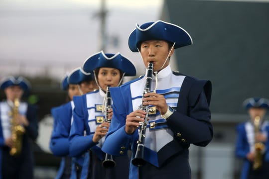 Freehold Boro Marching Colonials perform before the Freehold Boro vs. Rumson-Fair Haven homecoming football game at Rumson-Fair Haven High School in Rumson, NJ Friday, September 28, 2018.