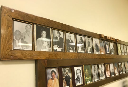 Pictures of Kelly Guerra's great-grandparents, top left, and grandmother center left, appear on the church's memory wall.