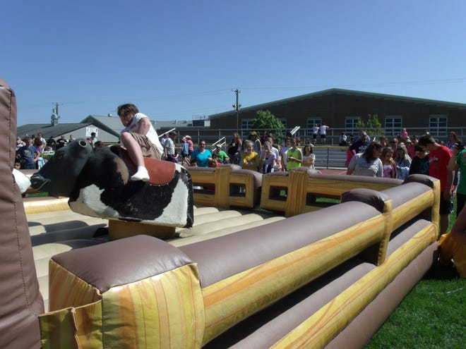 """The mechanical bull is always a big hit at Southern Regional High School's  """"Country Fair Ramboree,"""" as seen here in this 2014 file photo. This year's event will take place Oct. 20."""