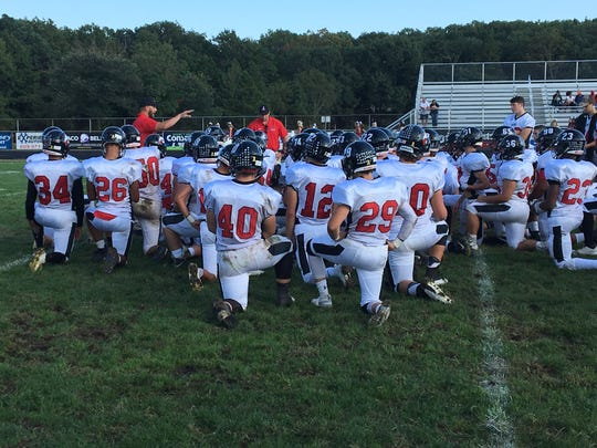 Jackson Memorial football team has a postgame chat with the coaching staff on Sep. 29, 2018 at Lacey High School