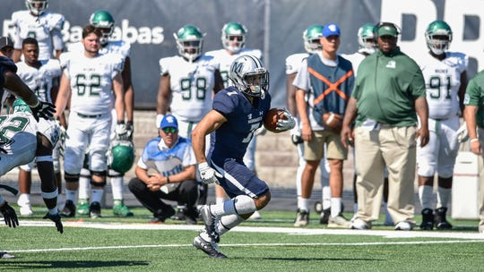 Monmouth's Vinny Grasso breaks into the open field against Wagner on Saturday at Kessler Stadium in West Long Branch.