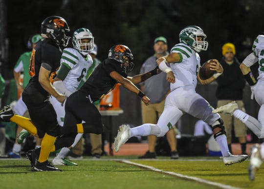 Jimmy Leblo of Brick breaks free for extra yards against Middletown North in a game in Middletown on Sept. 28, 2018.