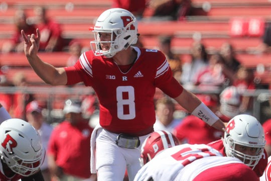 Artur Sitkowski (8) calls a play during the first half of their game against the Indiana Hoosiers