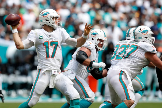 Miami Dolphins quarterback Ryan Tannehill (17) passes during the first half against the Oakland Raiders, Sunday, Sept. 23, 2018 in Miami Gardens, Fla.
