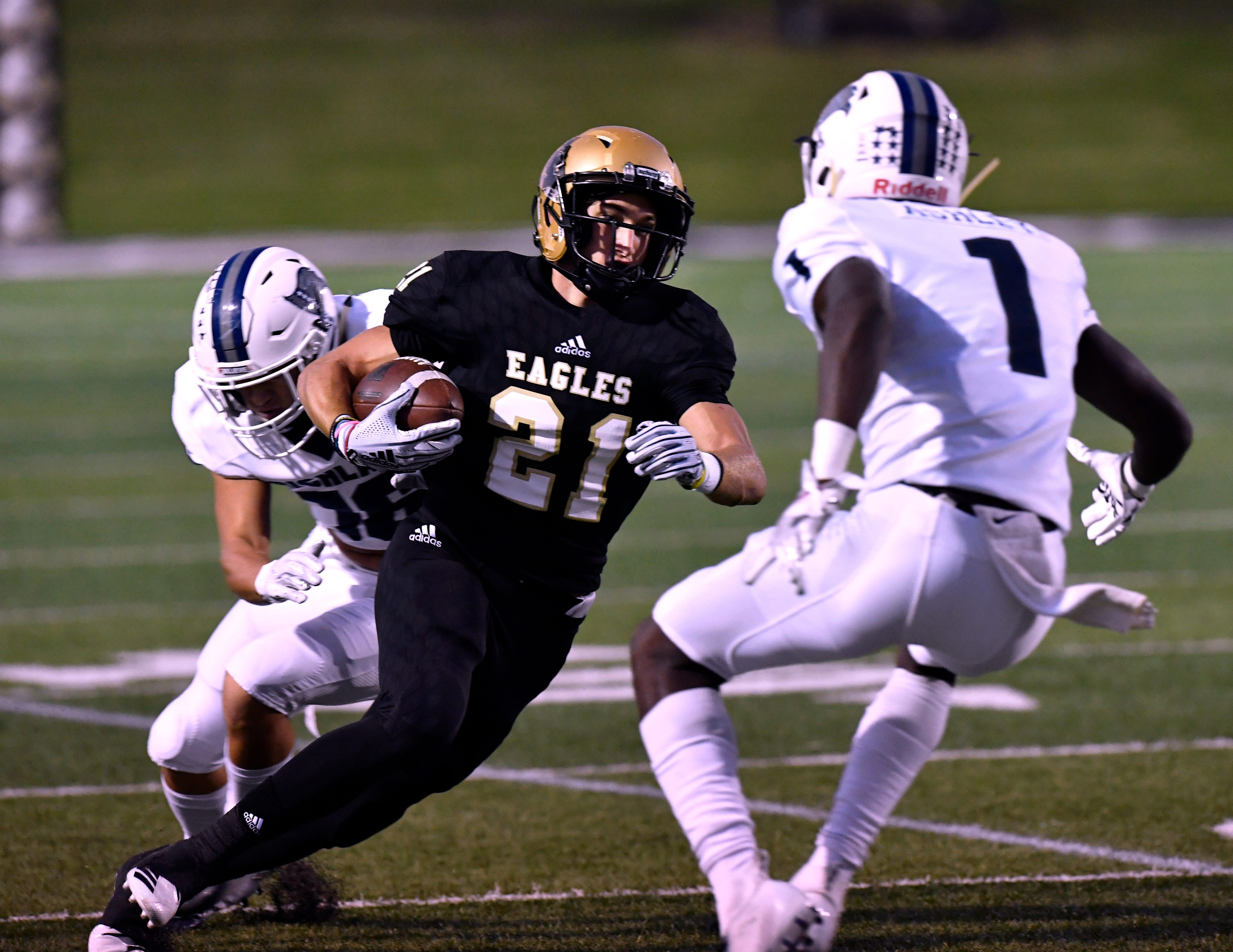 Abilene High receiver Reese Pettijohn tries to dodge Richland High's Ja'cory Ashley in the district opener at Shotwell Stadium. Pettijohn missed last week's game against L.D. Bell but his replacement, Marcos Garcia, came up big. Pettijohn is a game time decision Friday against San Angelo Central.