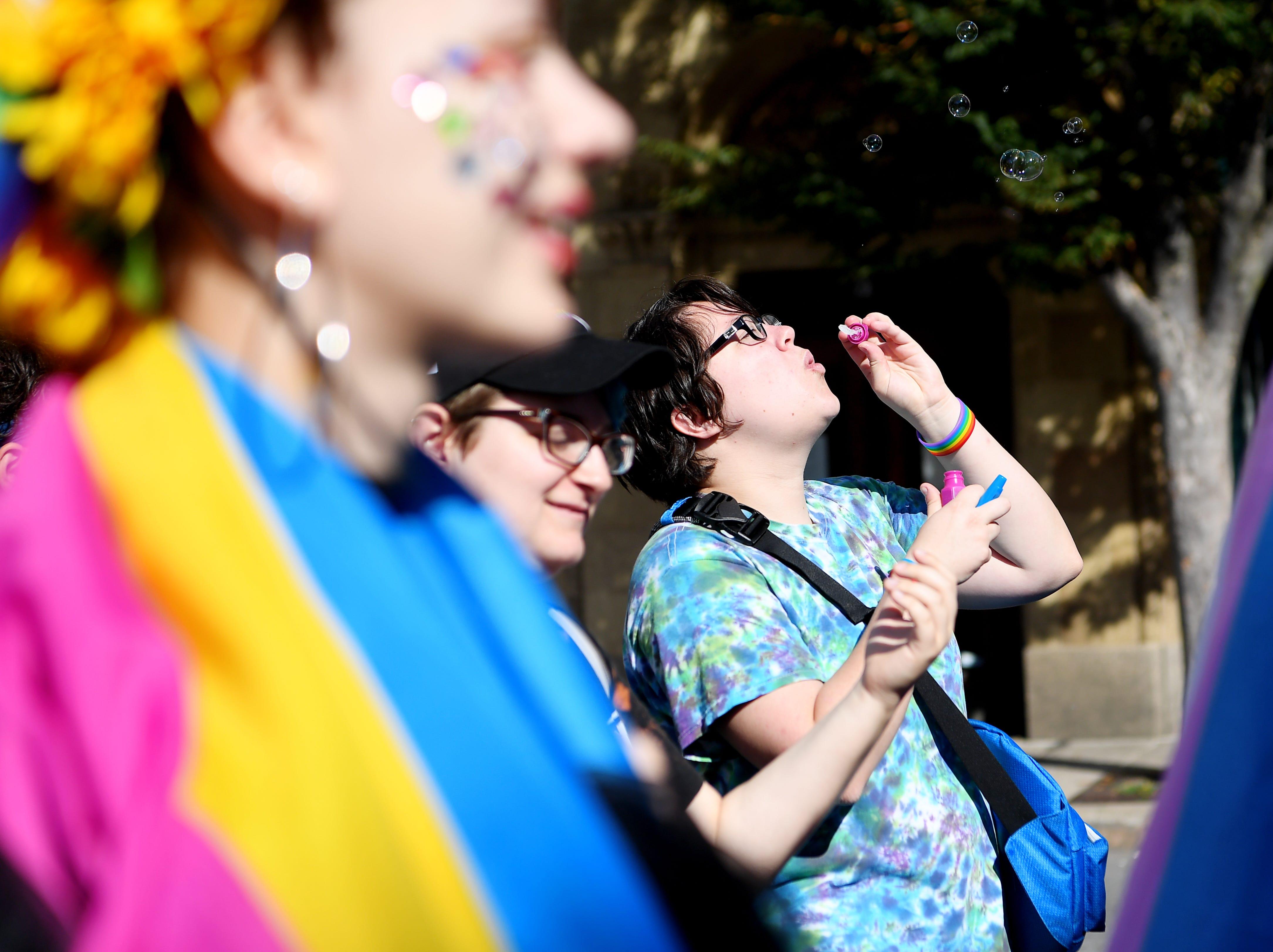 The Blue Ridge Pride procession walks up Patton Avenue to Pack Square Park Sept. 29, 2018 in Asheville.