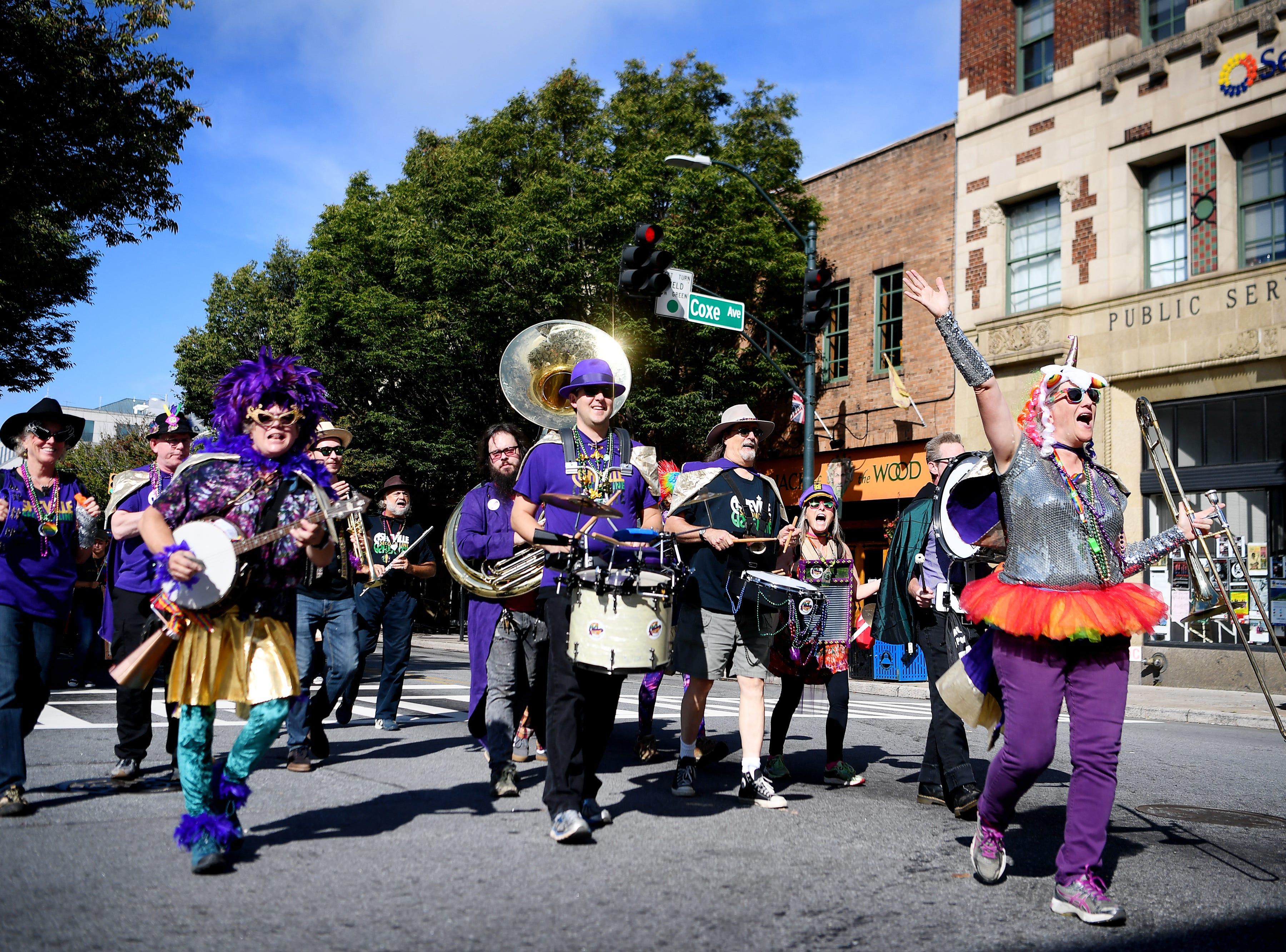 The Asheville Second Line band leads the Blue Ridge Pride procession up Patton Avenue Sept. 29, 2018.