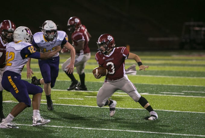 Asheville quarterback Three Hillier runs the ball on Friday, September 28th, 2018 as Asheville High beat out North Henderson at Asheville, with a final score of 50-14.  Hillier beat the school record for all-time passing yards during Friday's game.